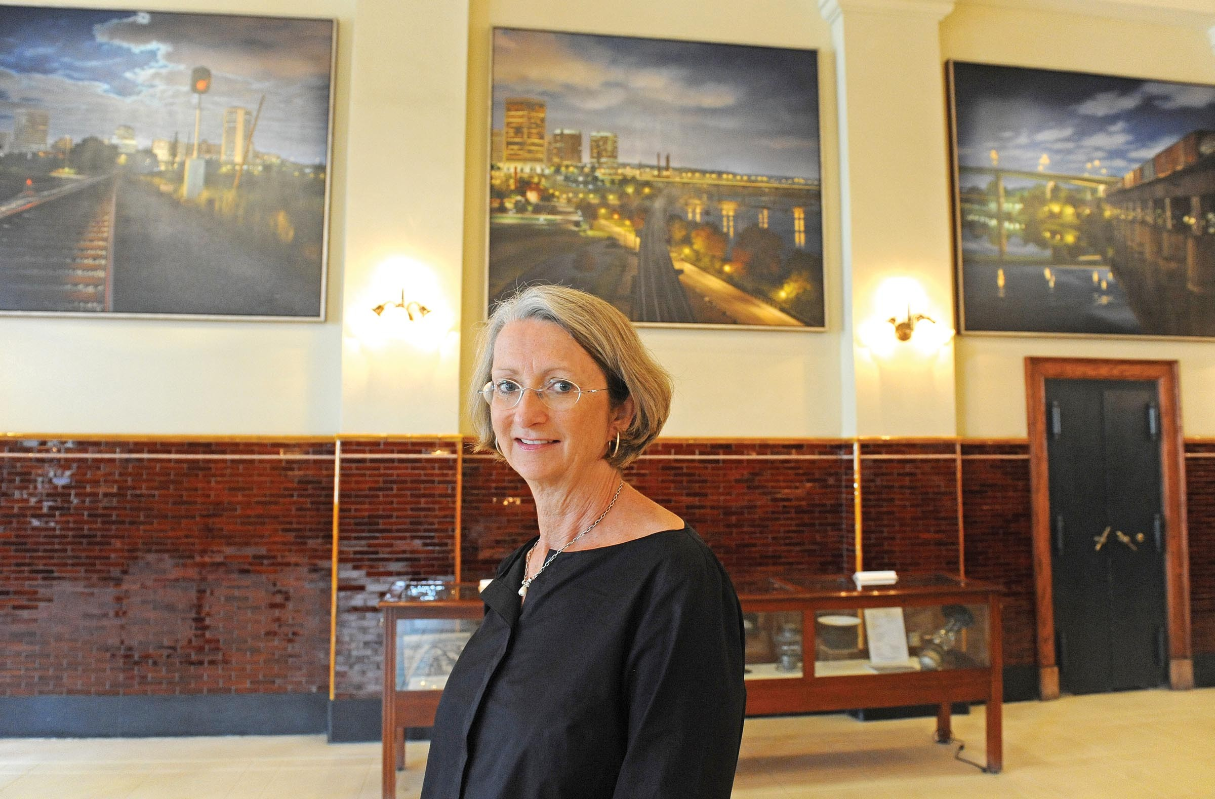 """The Public Art Commission welcomes debate, member Sarah Shields Driggs says, in front of a board-commissioned work, """"Main Street Triptych: Richmond Crossings"""" by Stephen Fox, at Main Street Station. """"Even if people disagree, it gets them talking,"""" she says. - SCOTT ELMQUIST"""