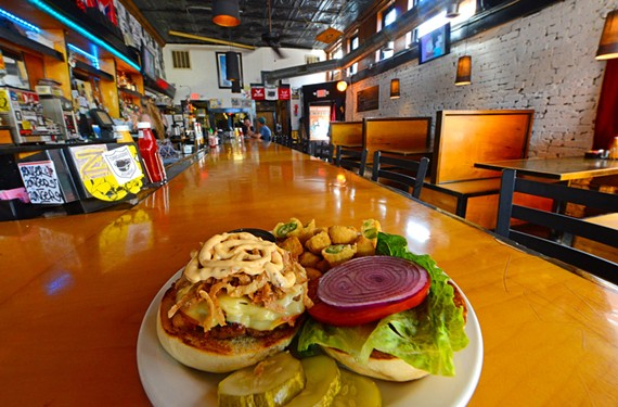 The Rockitz burger has bacon, tumbleweed onions, smoked Gouda and chipotle mayo. It's served with a side of fried okra and siracha-mayo dip at Empire, where new interior details strengthen its appeal.