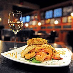 The seafood sampler at Outer Banks Seafood Company is now about $3 cheaper on a menu retooled for winter with lower-priced options.