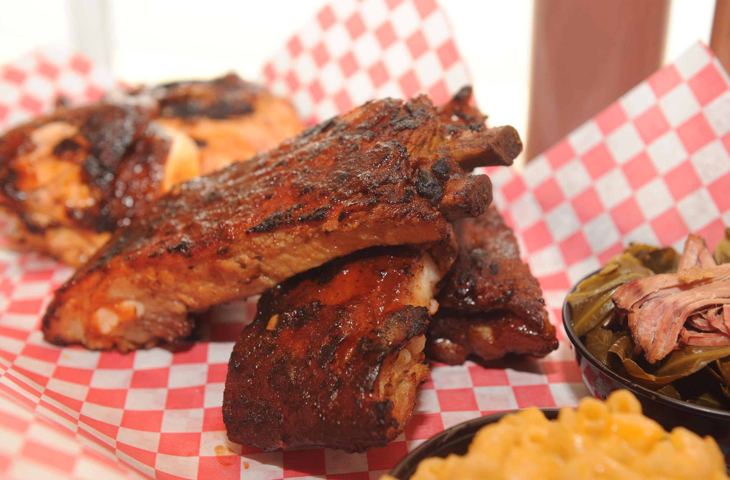 The sparerib platter at Deep Run Roadhouse comes with two sides, here greens and mac and cheese. - SCOTT ELMQUIST