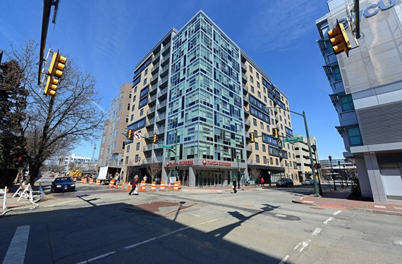 The Square apartment complex at West Grace and Shafer, by Walter Parks Architects, embraces the present with its distinctive glass walls.