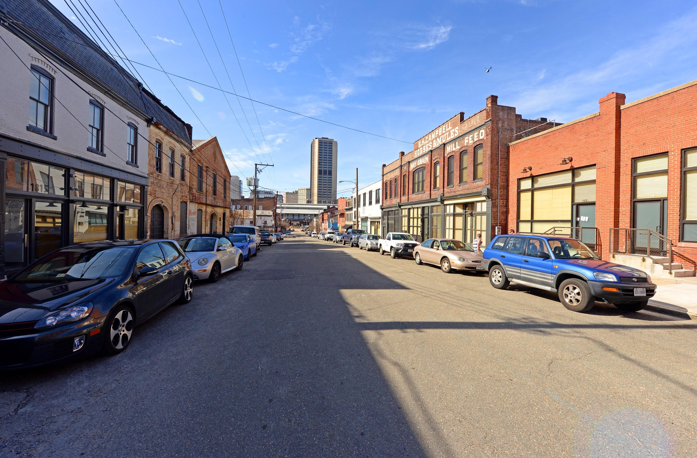 The view in Shockoe Bottom on East Franklin Street looking east toward the high rise Monroe Building. The historic and tight street grid here suggest how the district should be developed. - SCOTT ELMQUIST