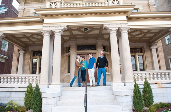 The Weissend family — Julie, Mary Genevieve, Grey and Paul — on the front porch of their Monument Avenue house, which before renovations housed the Senior Center of Richmond. - SCOTT ELMQUIST