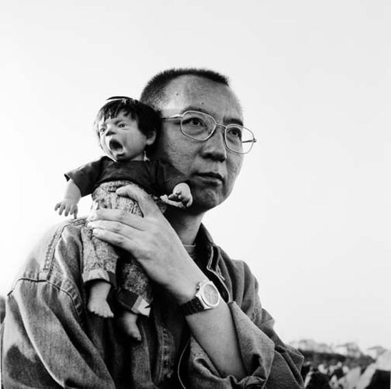 "This untitled photo features Liu Xiaobo holding his surrogate ugly doll that ""just can't keep its mouth shut,"" as photography critic A.D. Coleman describes it."