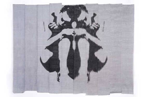 """To create """"Body Blot #1,"""" Andrea Donnelly unwove a painted image into warp and weft. She then rewove them into new cloth panels, creating a double image."""