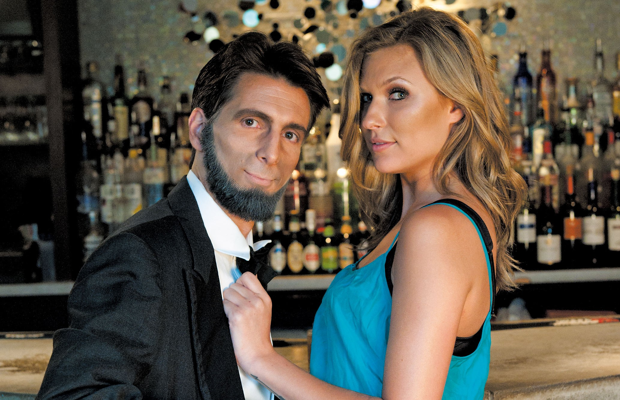 Toast across time: Bartender Otto Bartsch, of Bandito's Burrito Lounge and deLux, as Abraham Lincoln, with bartender Sara Paige of Cha Cha's Cantina. - SCOTT ELMQUIST