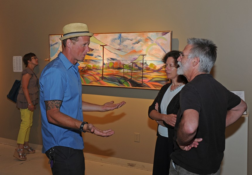 Trask talks to patrons at the opening of his show Friday at Glave Kocen Gallery. - ASH DANIEL