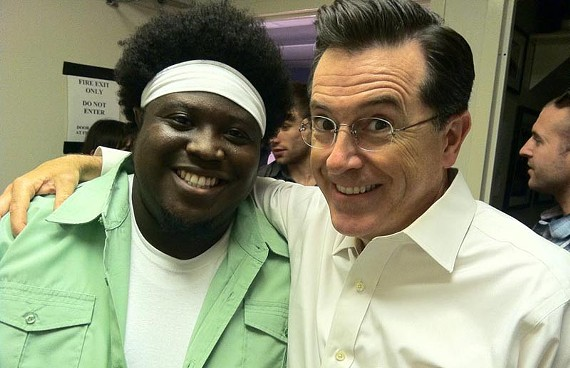 "Trombones for Truthiness: Reggie Pace hangs with host Stephen Colbert following Bon Iver's June appearance on Comedy Central's ""The Colbert Report."" The band's current CD is #2 on the Billboard charts."