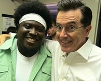 """Trombones for Truthiness: Reggie Pace hangs with host Stephen Colbert following Bon Iver's June appearance on Comedy Central's """"The Colbert Report."""" The band's current CD is #2 on the Billboard charts."""