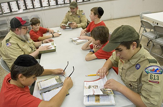 Troop 613 Boy Scouts learn how to identify signs of neighborhood wildlife. Clockwise from left are Berel Bart, Assistant Scoutmaster Drew Alexander, Noah Haine, Assistant Scoutmaster Ben Melton, Tzvi Plotnick, Michael Zedd and, in uniform, Mordechai Miller.