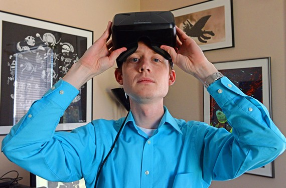 Tyler Rhodes wears a pair of Oculus Rift virtual reality goggles, for which he created a game populated by crayon drawings. - SCOTT ELMQUIST