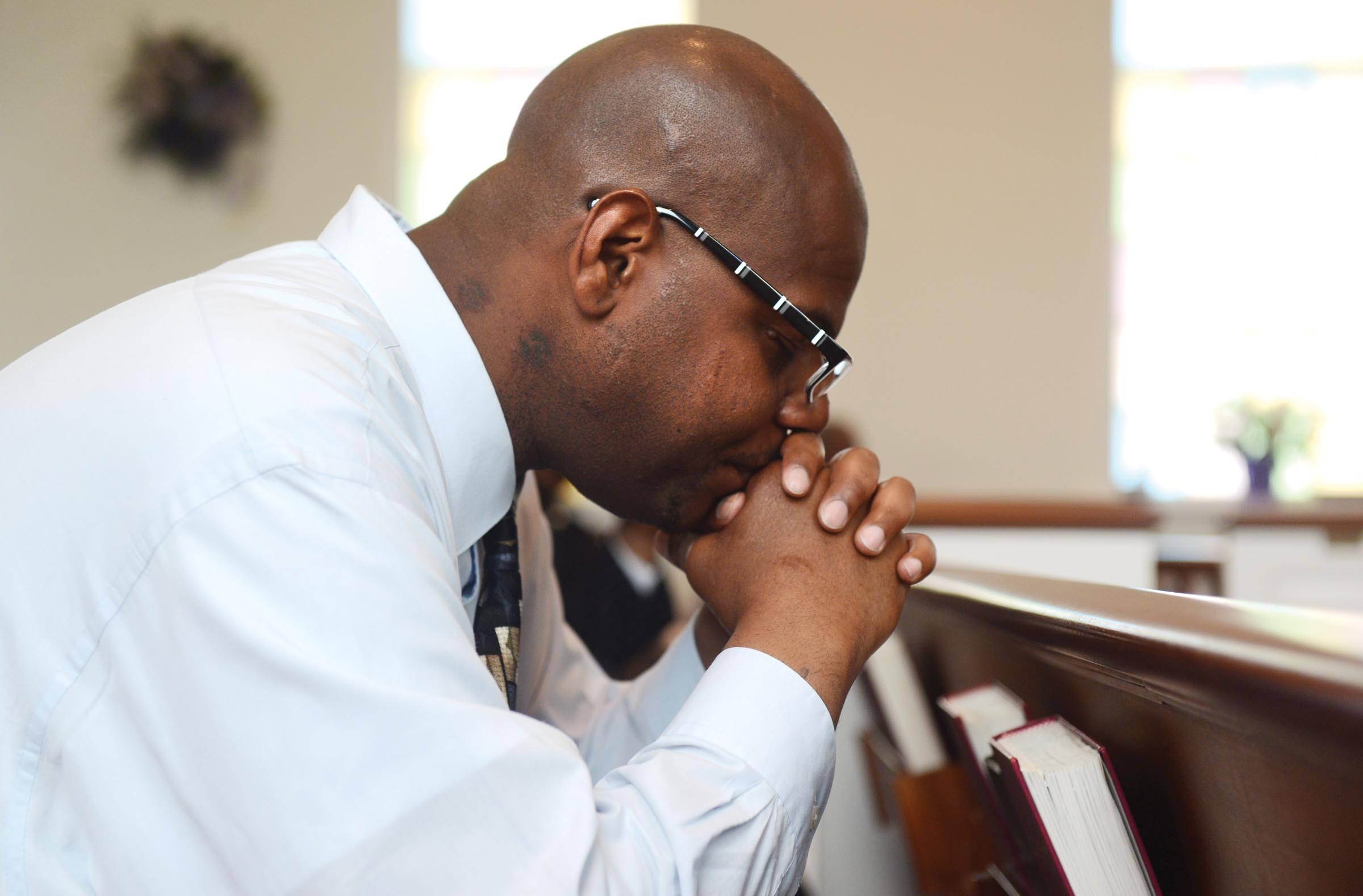Tyrone Fleming, currently a resident at the Kingdom Life Ministries transition house, spends a quiet moment prior to Sunday's service at Establish Covenant Ministries International. - SCOTT ELMQUIST
