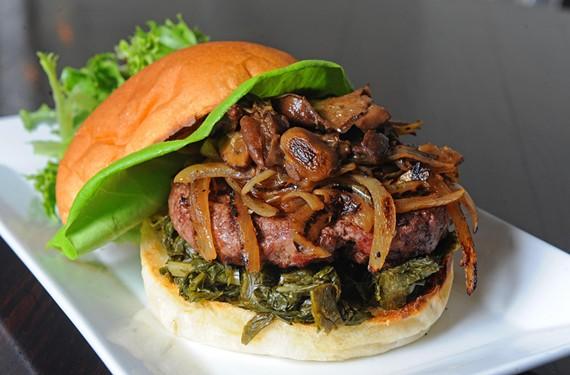 Postbellum's burger with charred onions, turnip greens, truffle mayo and ducky mushrooms. - SCOTT ELMQUIST