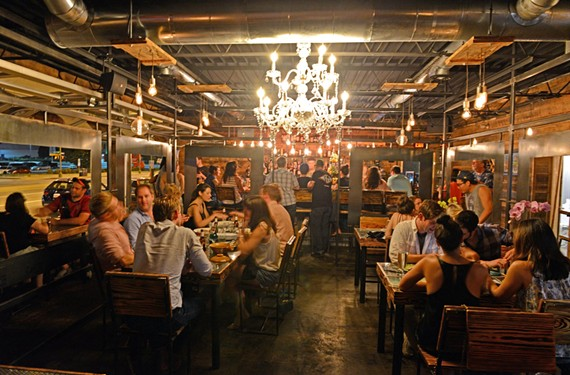 The crafted lighting, tables, wall, design — construction of Sabai, near the intersection of Broad and Boulevard, was a labor of love, co-owner Brandon Pearson says. - SCOTT ELMQUIST