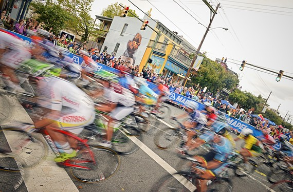 Riders take a turn at Lombardy and Main streets during the women's elite circuit race Saturday afternoon. For more photos from the races visit Styleweekly.com. - SCOTT ELMQUIST