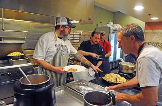 At the Appalachian Food Summit in September, Milton prepares a dinner for 100 with chef Jassen Campbell, at right. Not pictured are chefs John Fleer and Shelley Cooper. - SCOTT ELMQUIST