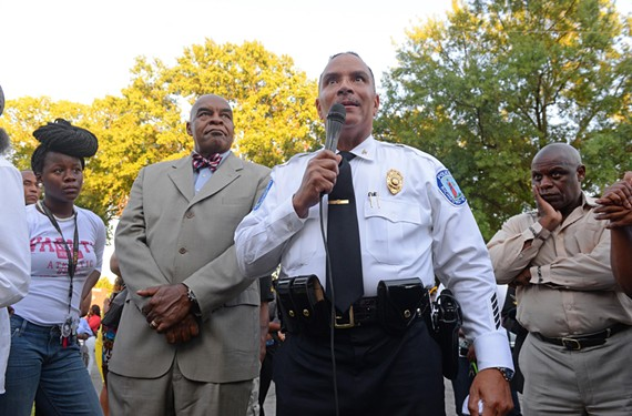 Richmond Police Chief Alfred Durham speaks at a vigil marking the deaths of Jawaun L. Hargrove, 33, and Anthony D. Addison, 21. Both men were fatally shot in Mosby Court in September. Durham says he's focusing police attention on the mounting number of homicides in the neighborhood. - SCOTT ELMQUIST