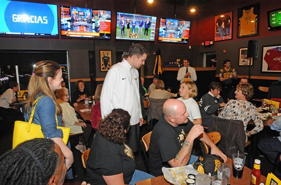 Wade meets with fans and well-wishers at the Buffalo Wild Wings last month in Short Pump before a taping of his coach's show, which airs on ESPN-AM 950. - SCOTT ELMQUIST