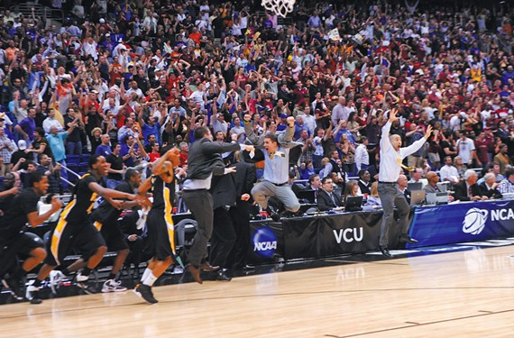 Wade celebrates during his tenure as assistant coach with the Rams, after a win over Kansas sent the team to the Final Four in 2011. - SCOTT ELMQUIST