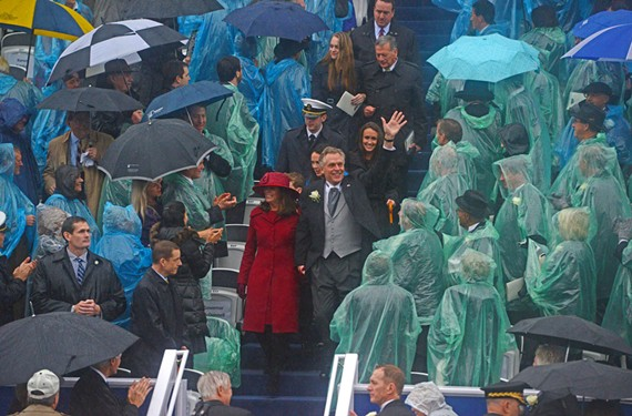 Virginia's incoming first family makes its way down the Capitol steps Jan. 11, 2014, for the swearing in of Terry McAuliffe as governor. Under an umbrella at lower left, Bill Clinton applauds. - SCOTT ELMQUIST