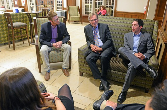 Adams, at center, meets with students Charlie Hackley and Ben Acton after a class he teaches at the University of Richmond.