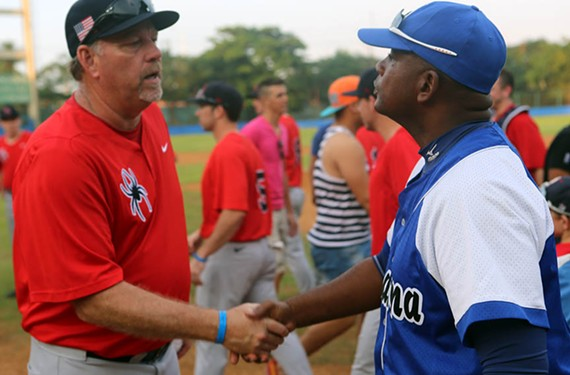 After a game, Spiders head coach Tracy Woodson shakes hands with the head coach of La Habana. - UNIVERSITY OF RICHMOND ATHLETICS