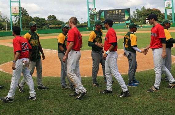 The Richmond and Pinar del Rio teams shake hands after facing off during game three in Vinales. - UNIVERSITY OF RICHMOND ATHLETICS