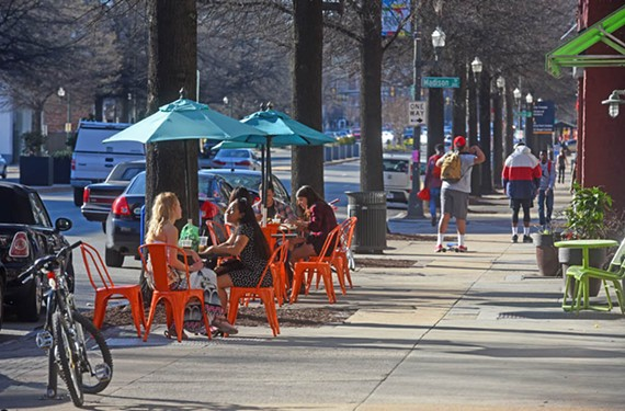 Customers lounge outside of Lift Coffee Shop and Café for leisurely sips. Business for Lift and other eateries has picked up on Broad Street in recent years. - SCOTT ELMQUIST