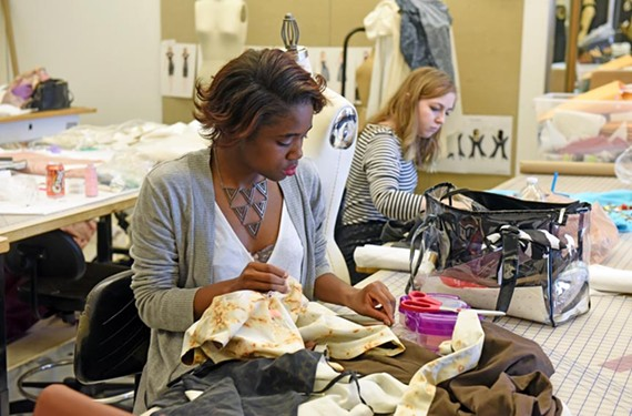 """Students Toni Johnson and Shelby Rider prepare their creations for the juried show, """"Runway 2016: Emerge,"""" set for May 8 at the Virginia Museum of Fine Arts. - SCOTT ELMQUIST"""