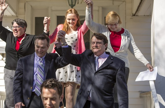 Emily Schall-Townley, 16, lifts her mothers' hands in victory Feb. 14, 2014, a day after a federal judge struck down Virginia's ban on same-sex marriage. Carol Schall and Mary Townley joined co-plaintiffs Timothy Bostic and Tony London. - BILL TIERNAN