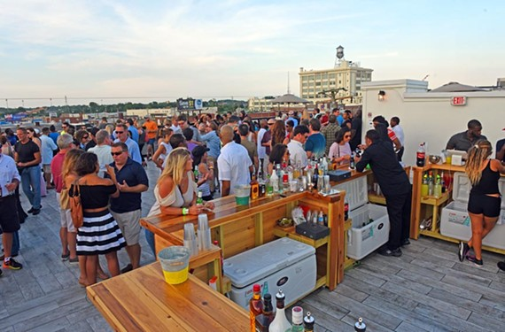 The rooftop is hopping on Thursdays at the Hofheimer Building on the outskirts of Scott's Addition. The Sunsets at the Hof series will continue throughout the summer. - SCOTT ELMQUIST