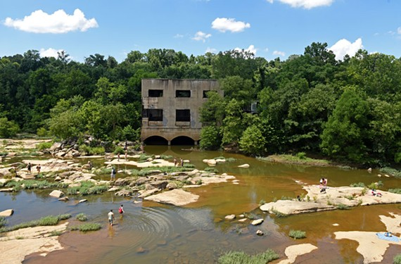 A former hydroelectric plant on the eastern end of Belle Isle rises from a popular swimming hole. - SCOTT ELMQUIST