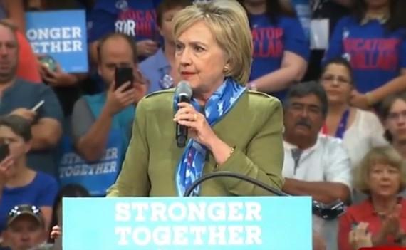 Clinton wearing her scarf designed by a VCU fashion grad.