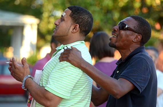 "Habeed ""Sam"" Hafeed's close friend, Noah Maqsher, is comforted by Sylvester Barksdale, who led the Aug. 29 vigil. - SCOTT ELMQUIST"