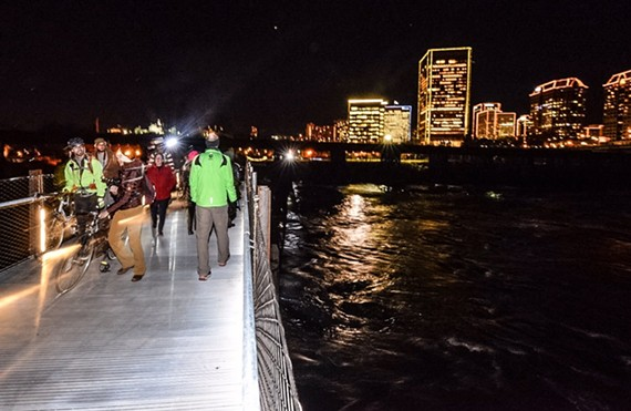 People venture across the new T. Tyler Potterfield Memorial Bridge, which opened during downtown's 2016 Grand Illumination. - SCOTT ELMQUIST