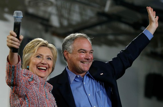 A week before Hillary Clinton officially names Tim Kaine as her running mate, she invites the senator to help rev up the crowd during a July 14 rally in Annandale. - CARLOS BARRIA/REUTERS