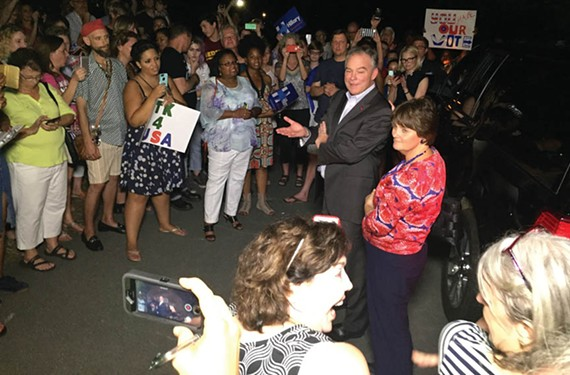 Kaine and his wife, Anne Holton — who resigned her post as Virginia's secretary of education to campaign for her husband, find friends and neighbors gathered outside their house July 23, upon returning to Richmond after Kaine's vice-presidential selection. - MIKE VALERO/NBC12