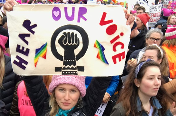 Molly Artz of Richmond enjoys the choatic, crowded march. - JAMIE GONTHIER