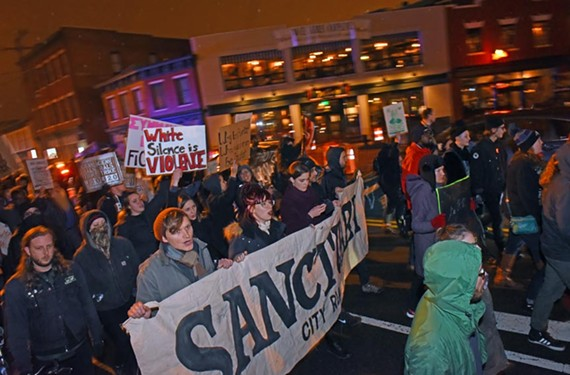 Protesters at Adams and Broad streets support sanctuary on Inauguration Day. - SCOTT ELMQUIST