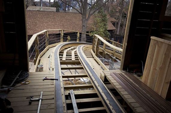 The new coaster has 96,000 bolted connections, used more than 10,000 pounds of nails, 360,000 pounds of steel,10,000 cubic feet of lumber and 2,500 cubic yards of concrete. - L. TODD SPENCER