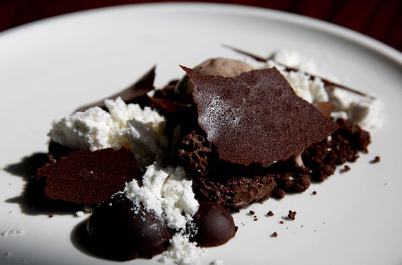 "A chocolate themed dessert called ""Fun with Chocolate"" features powdered white chocolate, chocolate bark, milk chocolate ice cream, aerated chocolate and chocolate palet d'ors. - KRISTEN ZEIS"