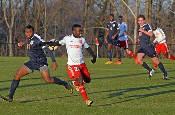 Richmond Kickers midfielder Samuel Asante, center, battles a University of Virginia player for the ball at the teams' pre-season scrimmage March 4. - SCOTT ELMQUIST