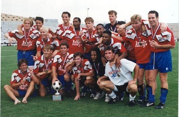 The 1995 team after winning the Open Cup in El Paso, Texas, a national tournament that pitted the new, lower division team against higher division ones. Players who are now team officials include Cowlishaw, back left, and three players over, Rob Ukrop. - RICHMOND KICKERS
