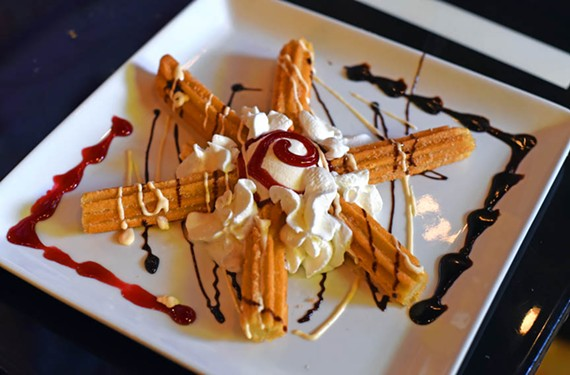 A churro for dessert at Alero Mexican Restaurant. - SCOTT ELMQUIS