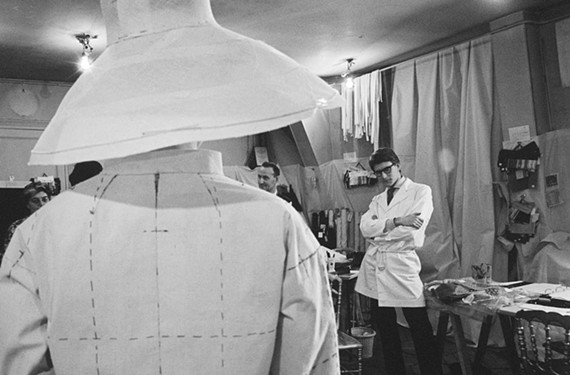 Thrust into the spotlight after the death of his mentor, young fashion designer Yves Saint Laurent prepares his first collection in December 1961. - PIERRE BOULAT