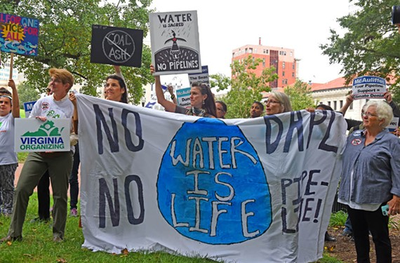 People protest coal ash leaks and pipelines at Capitol Square in October. Water quality issues have made headlines across the country this past year, including the Dakota Access Pipeline and drinking water contamination in Flint, Michigan. - SCOTT ELMQUIST