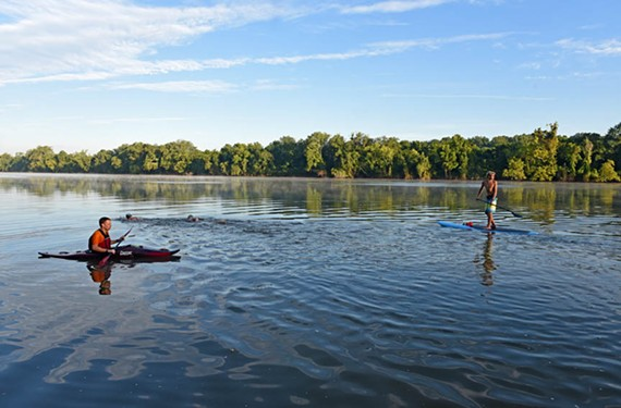 Trinity Episcopal students swim and paddle to school in the West End last year. - SCOTT ELMQUIST