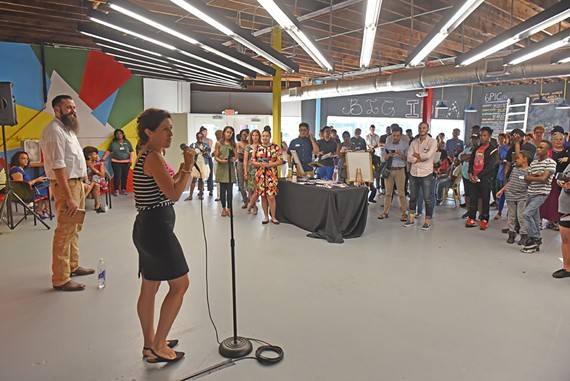 Giles Harnsberger, executive director of Groundwork RVA, speaks before the opening day crowd at Six Points Innovation Center at 30001 Meadowbridge Road.