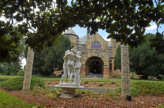 """""""The Three Graces"""" a reproduction of an Antonio Canova  sculpture, and limestone Romanesque-style columns are shaded by a magnolia tree near the Maymont house."""