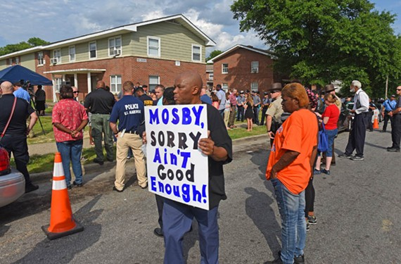 On Memorial Day, a vigil for Virginia State Police Special Agent Michael T. Walter was held at Mosby Court. He was shot while on patrol. - SCOTT ELMQUIST